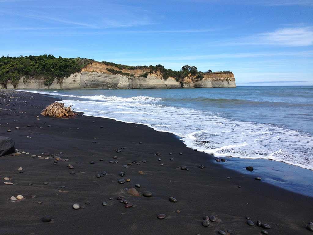black sand beach new zealand